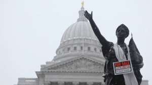A statue at the Wisconsin State Capitol during a protest, from the film Citizen Koch (2013), photo courtesy of Matt Wisniewski